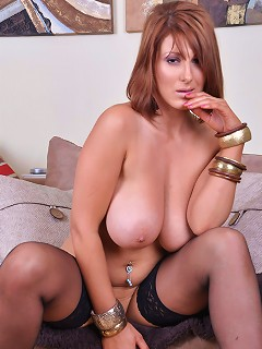 Lexy strips off to show off her giant boobs and shaved pussy