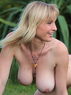 Petra plays with her juggs and dildo fucks her cunt outdoors